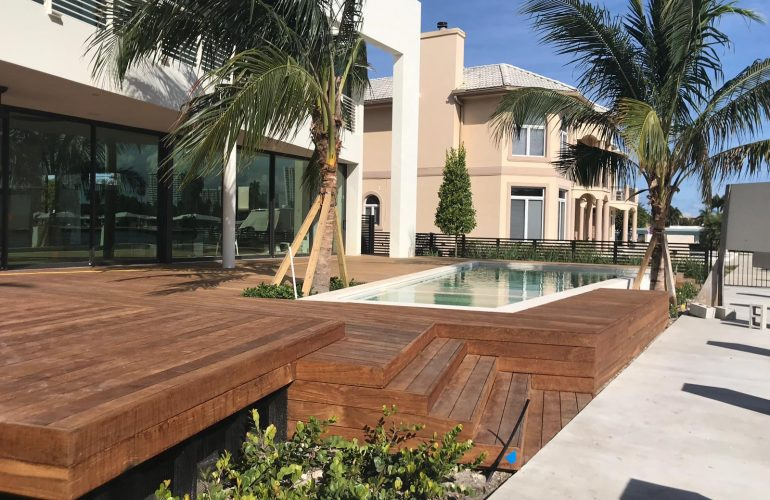 Modern Ipe Multilevel Wood Deck Surrounding an Infinity Pool Brings Stylistic Harmony to This Luxury Home